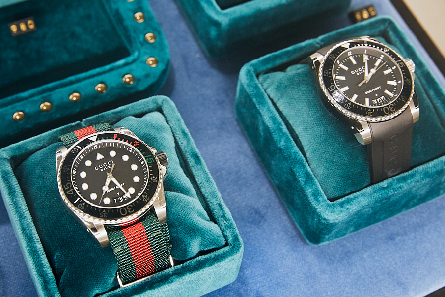 close up of Gucci watches in display boxes