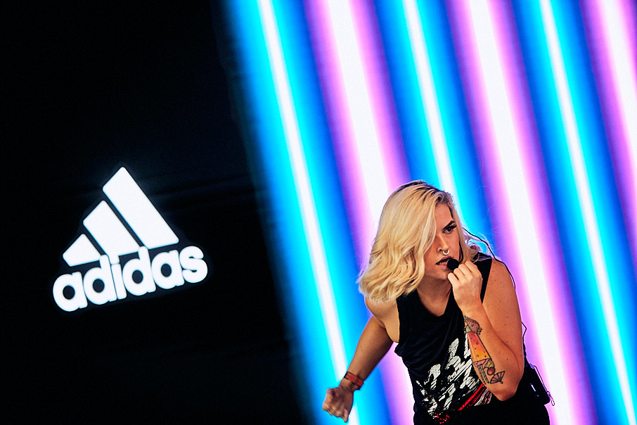 Adidas event with woman presenting on stage