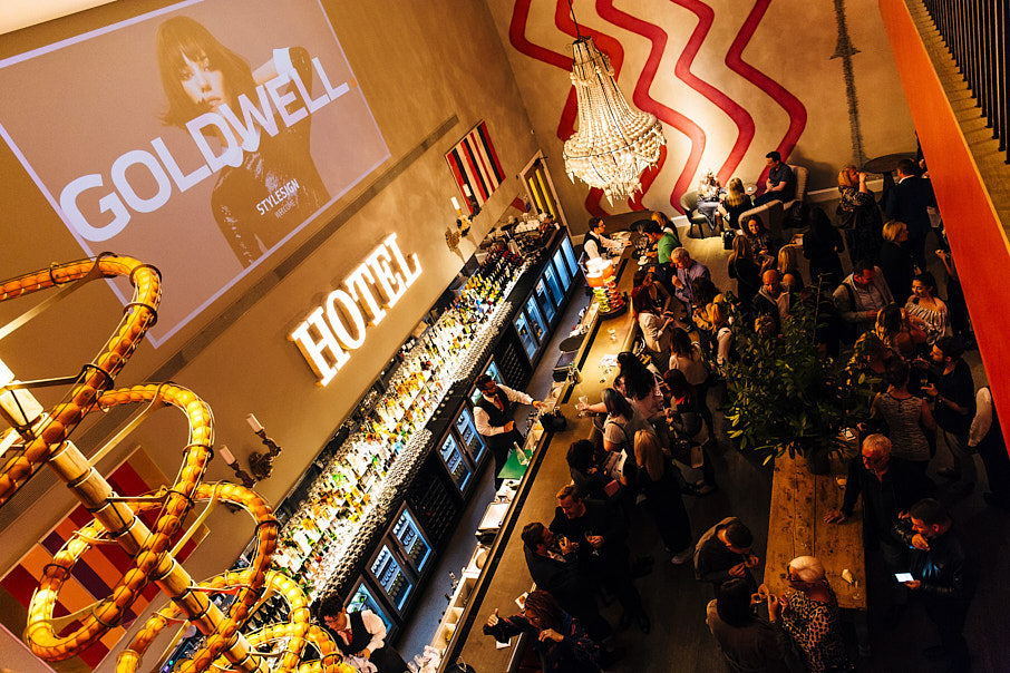 elevated shot of hotel bar during an event with lots of people