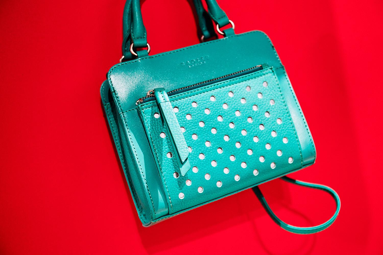 Green handbag on red background