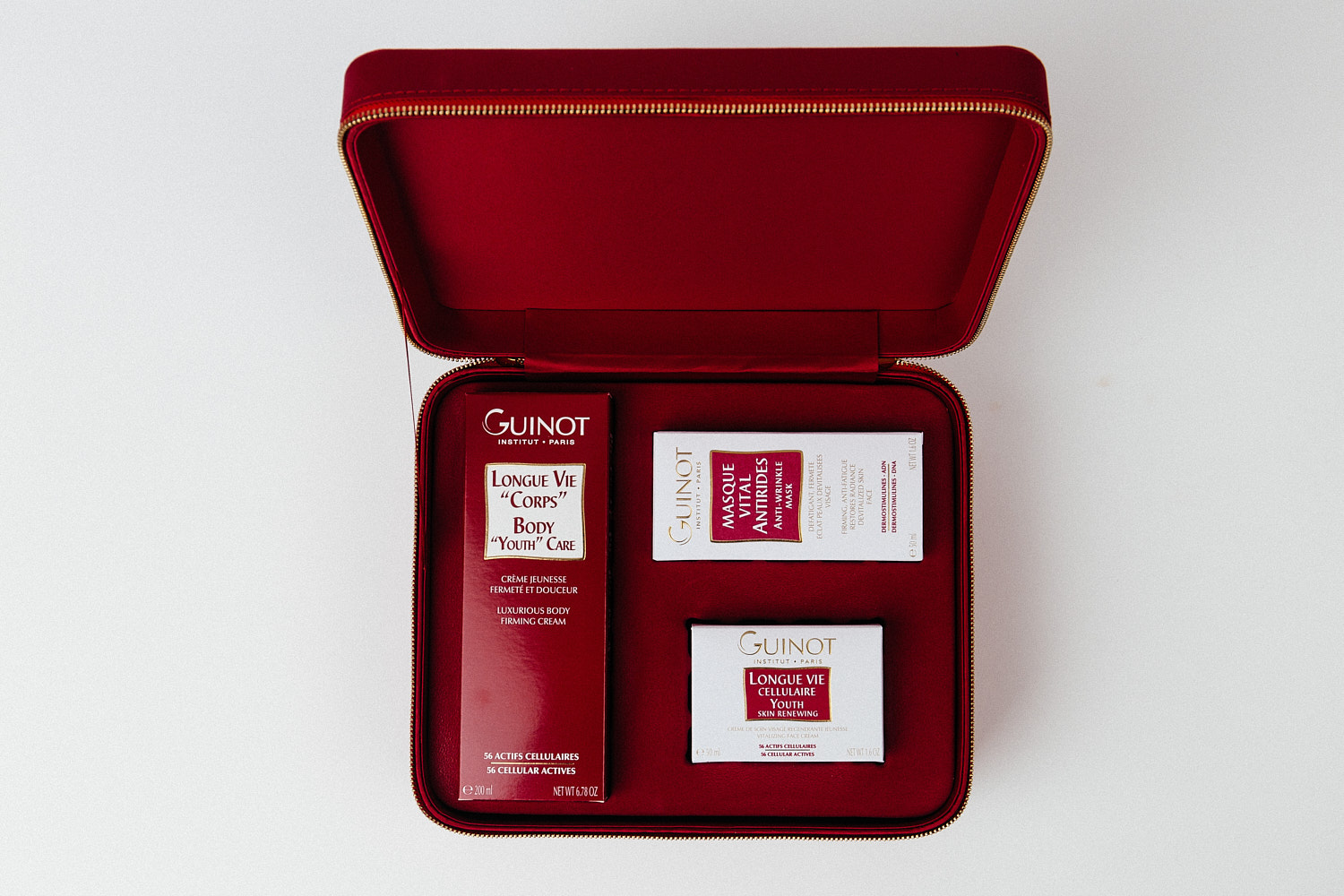 Packshot of beauty products in red leather box