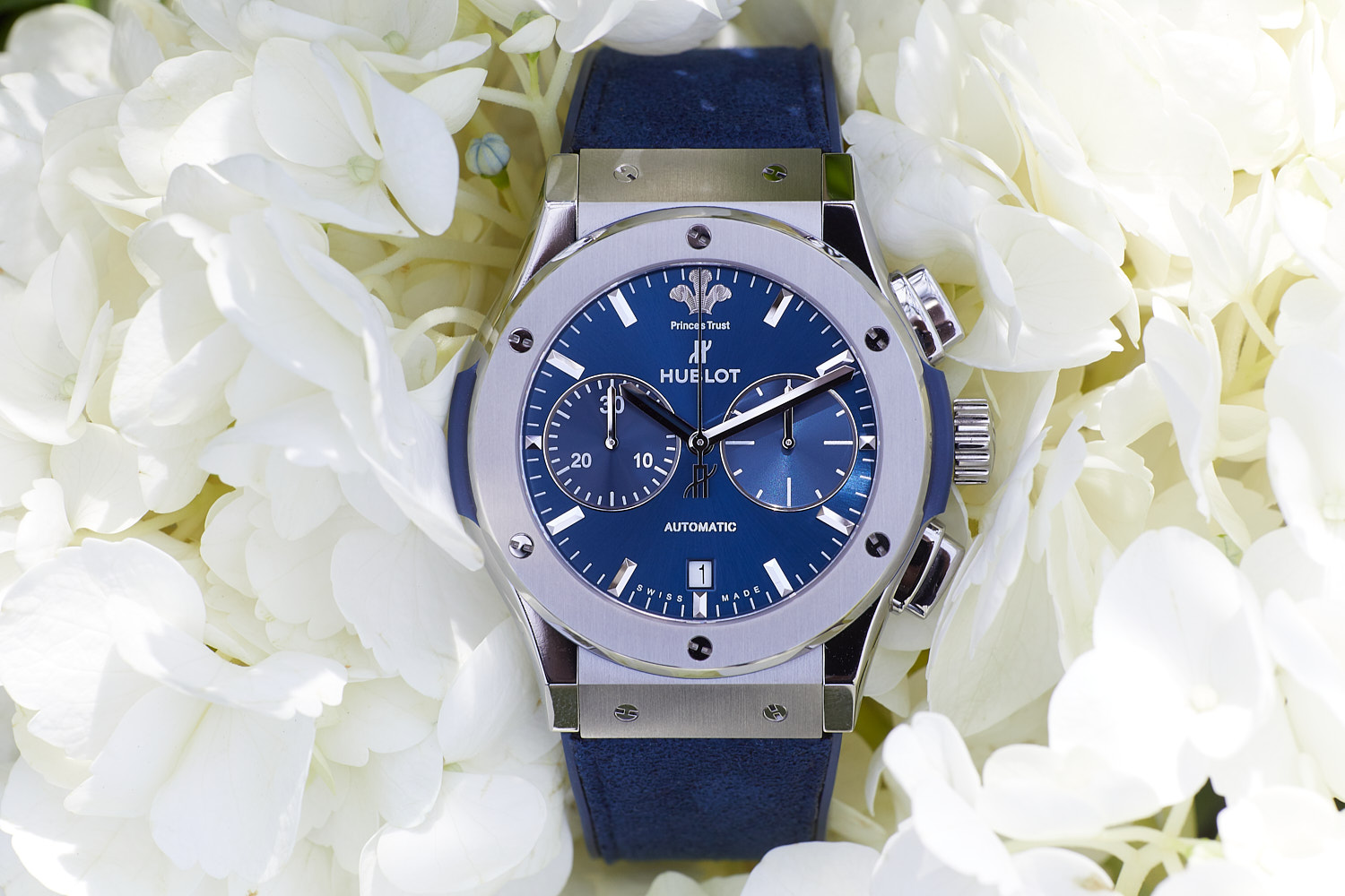 blue gents watch photographed in white flowers