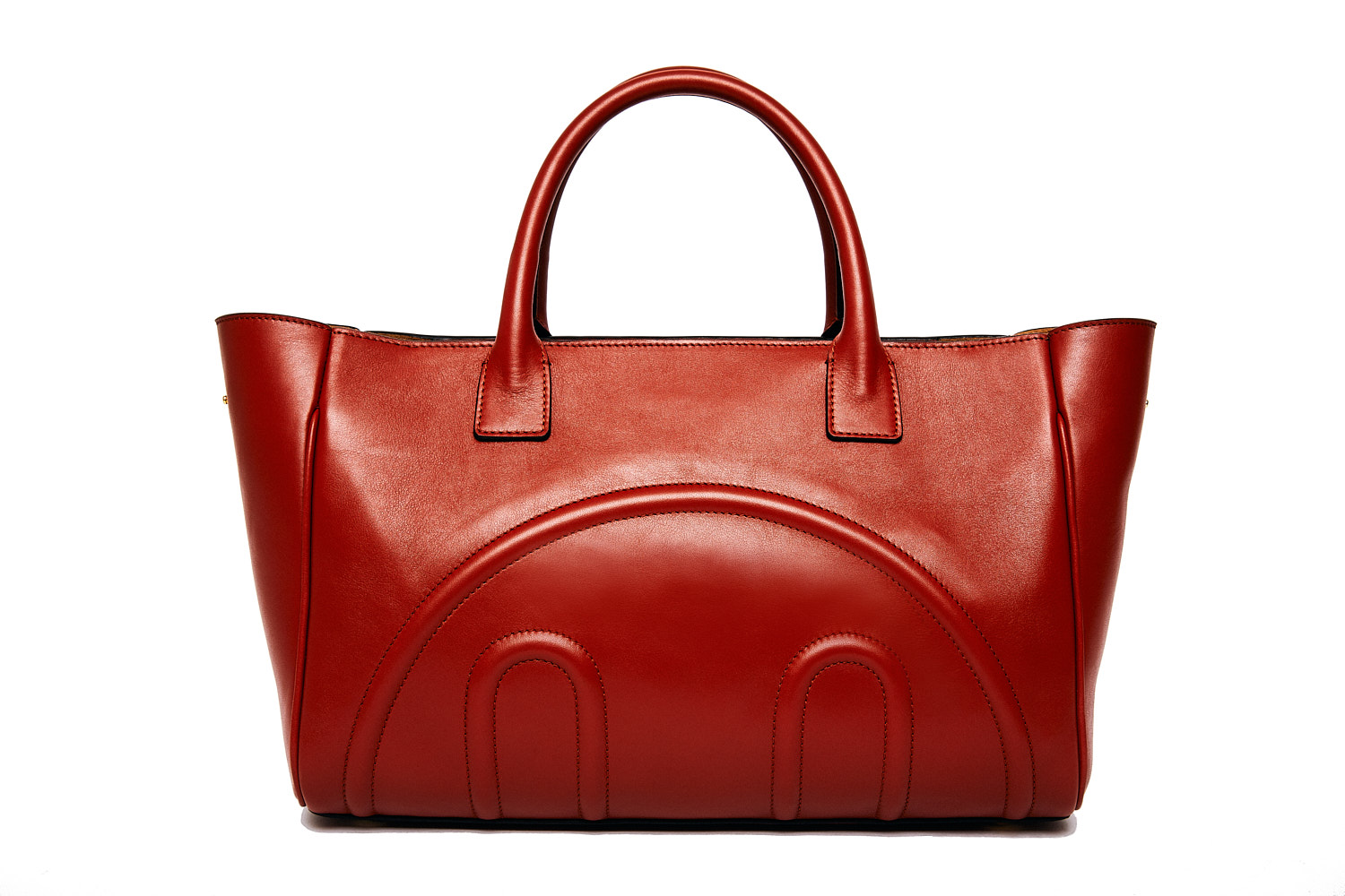 Red leather handbag cut out against a white background