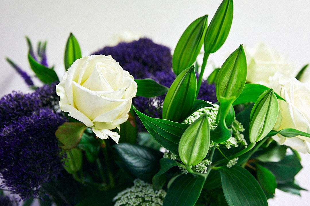 Purple, white and green floral arrangement