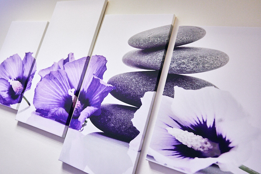 Canvas wall art showing purple flowers and stones