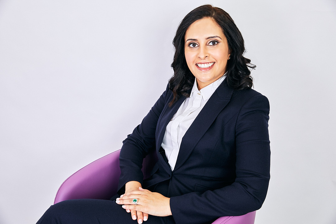 business headshot of a woman in a chair